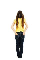 Back view of little girl with both hands in her pockets
