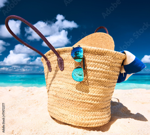 canvas print picture Beautiful beach with bag at Seychelles