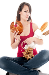 Attractive young woman with bagel, isolated on white background.