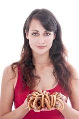 Woman  with a bunch of bagels, isolated on white background.