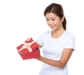 Woman look at red gift box