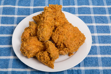 Crisp Fried Chicken on White Plate and Blue Towel