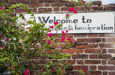 Immigration Sign on an Old Brick Wall
