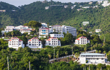 Luxury White Stucco Condos on Green Tropical Hillside