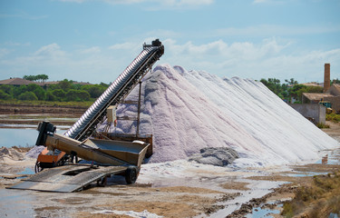 Sea salt production. The conveyor belt with salt.