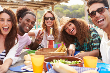 Group Of Young Friends Enjoying Lunch Outdoors