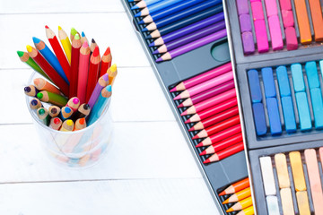 Multi colored pencils in jar with pastel and pencils box