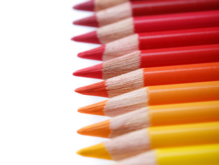 Color pencils in a row, isolated on white, shallow dof