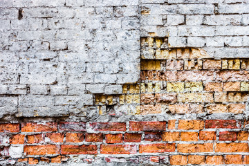 The old damaged brick wall with rich texture