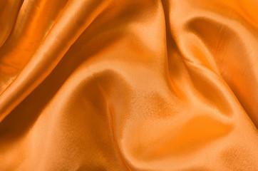 Texture orange satin, silk background