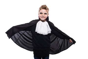 Cute boy dressed up as vampire for the halloween party