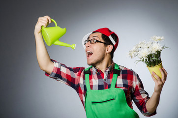 Funny man with watering can