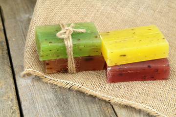 Colorful natural herbal soaps on burlap,