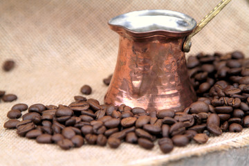 Coffee beans and traditional Turkish copper coffee pot