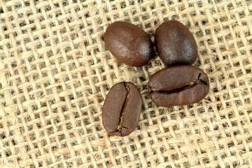 Coffee beans on a linen sack. Macro shot.