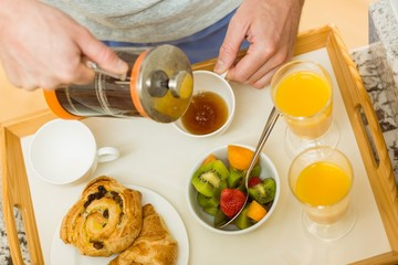 Man preparing a breakfast tray