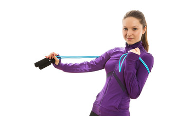 Beautiful young woman with jump rope
