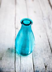 blue gerbera flower in a vase on wooden background