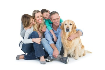 Portrait of smiling family sitting together with their dog