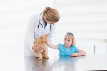 Vet holding a cat