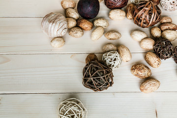 Brown rattan balls on old wooden background