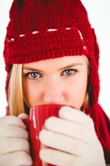Festive blonde drinking from mug