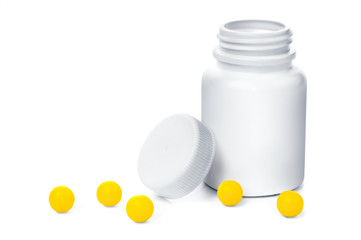 Open plastic medical container with yellow vitamins