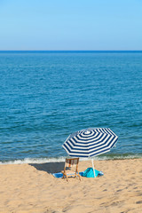 beach umbrella in front of the blue sea