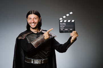 Knight with the movie board clapperboard