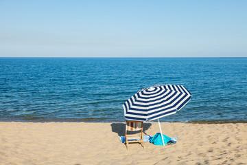 beach umbrella in front of the blue sea