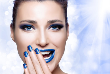 Beautiful Girl in Blue. Nail Art and Makeup