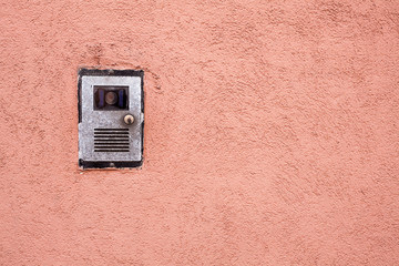 Intercom on red wall