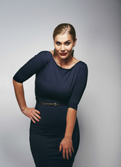 Beautiful caucasian plus size model in dark blue dress