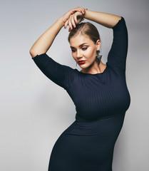 Elegant young lady posing on grey background