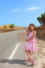 young girl hitchhiking