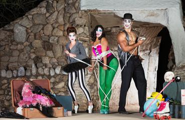 Clowns Tying Up Woman