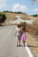 brother and sister walking around the street
