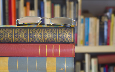 books with spectacles, library concept
