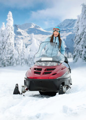 Portrait of woman on snowmobile. Concept of snow sport