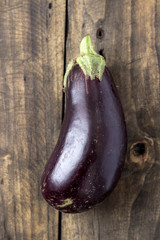 Raw aubergines or eggplants on wooden backround.