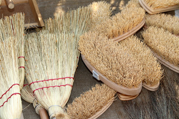 old brooms, brushes and natural material for sale to the market
