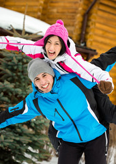 Half-length portrait of happy couple having fun outdoors