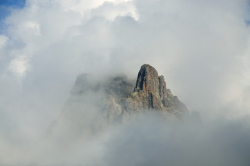 Mountain peak among the clouds