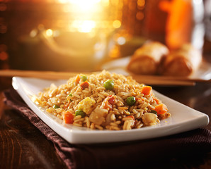 chinese fried rice on plate with orange glow