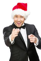 Half-length portrait of businessman wearing Santa Claus cap