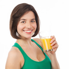 Smiling young woman drinking an orange juice