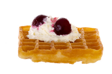 Cherries and whipped cream on freshly baked waffle