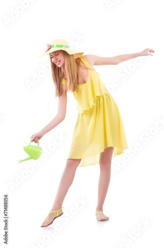 canvas print picture Woman in yellow dress with watering can