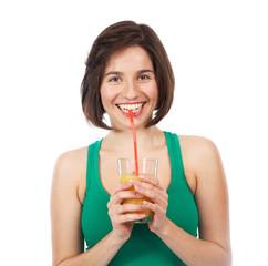 Smiling brunette and orange juice