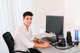 handsome young man editing photography with graphic tablet poster